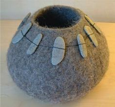 Bowlder by Jenny Pepper via craft Love the stone embellishment on this piece. She also uses other found objects such as feathers and driftwood to embellish her work.