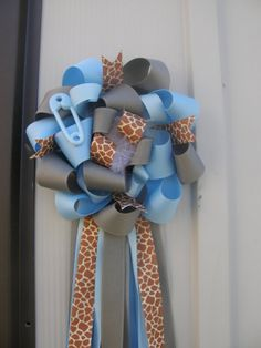 giraffe baby shower-corsage .... Love the fullness minus the giraffe theme