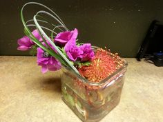 Hot pink and orange flower flowers arrangement for wedding and event.