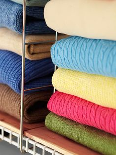 Folded Clothing Storage     Premade pallets of thin cedar planking and a chrome vertical divider, above, snap into place on a wire shelf to keep folded clothing neatly stacked and separated by type, season, or owner