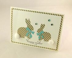 Card: Easter Embellishments: sequins, cottontails Description: Card is stamped using high quality stamps, inks, card stock and embellishments. Two Bunny Buddies face each other in different sizes with a bow to dress up each bunny.... The card front is cut with negative space and