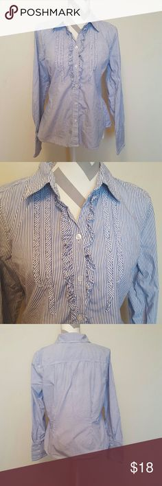 American Eagle Pin Striped Career Shirt Price Reduced! American Eagle brand in a size Medium.  The size tag has been cut out but I believe it is a Medium. The top is button up, has a ruffled front, collar, and the sleeve cuffs have buttons.  Measurement laying flat and unstrecthed from armpit to armpit is about 17-18. Smoke free home and fast shipping. I do offer bundle deals as well. Thank you for checking out my closet. American Eagle Outfitters Tops