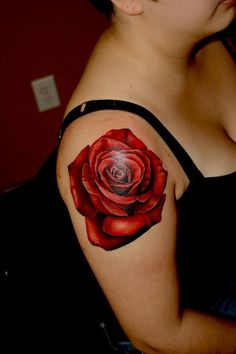 Red rose tattoo by Cara Hanson. Tattoosbycara.com