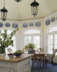 love the high ceiling, windows, and blue/ivory platters