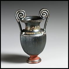 Terracotta miniature volute-krater (mixing bowl)    Period:      Late Classical  Date:      ca. 325–300 B.C.  Culture:      Greek, South Italian, Apulian, Gnathian  Medium:      Terracotta  Dimensions:      H. 5 7/8 in. (14.9 cm)  Classification:      Vases