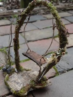 Fairy Swing for Faerie Fae Garden or House Dollhouse Miniature Swing. $79.95, via Etsy.