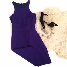 J.Crew Dark Royal Purple Fitted Dress I wore this once for New Years in NYC at a dinner for a few hours. It got a million compliments! Stunning royal purple color with modern neckline. Back zipper. Fitted and very flattering. Clean condition. Retailed for $198. Looks amazing paired with heels and J.Crew jewelry! J. Crew Dresses