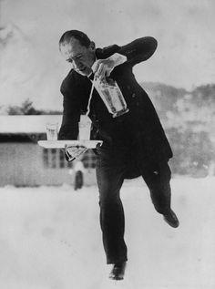 Ice Skating Waiter, St. Moritz 1932 by Alfred Eisenstaedt