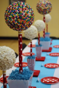 Idea: Popcorn balls on a pixie stick and could write guest's names with frosting.