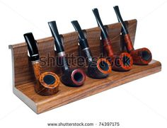collection of smoking pipes on wooden stand by dean bertoncelj, via ShutterStock
