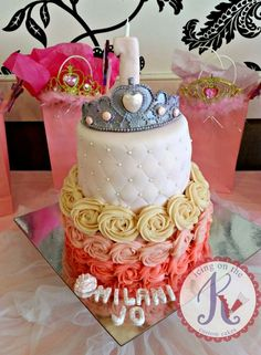 Tiara Rosette Cake: [tier1] strawberry cake + strawberry filling. buttercream ombre rosettes. [tier 2] vanilla cake + strawberry filling. fondant frosted and with tufted pattern. sugar pearls. gumpaste tiara with pearl dust.