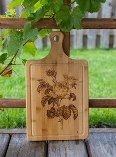 Gift for her! This is a beautiful Roses freehand pyrography art, custom design that is burned onto a 9 x 15.5 (22.8 x 39.3 cm) high-quality real bamboo cutting board and mineral-oiled to be food safe! Board thickness is 5/8 (1.6 cm).  This custom art-crafted board makes a perfect Thanksgiving, Halloween, Housewarming, Holidays, Christmas, Wedding, Anniversary or Birthday present! This unique, one-of-a-kind gift has a warm and personal feel that will touch the special person in your life!...