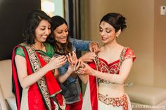 indian wedding bride getting dressed traditional http://maharaniweddings.com/gallery/photo/8263