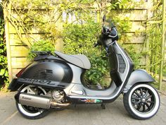 Modern Vespa : Orange gts super sport with white wall tires picture wanted