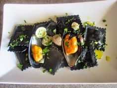 RAVIOLI OF BLACK SQUID INK FILLED OF SCALLOPS WITH SEAFOOD - Ravioli al nero di seppia ripieni di capesanta con frutti di mare