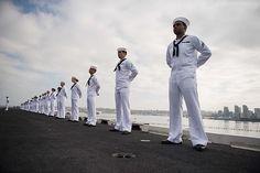 Sailors man the rails aboard USS John C. Stennis (CVN 74) as the ship pulls in to San Diego.
