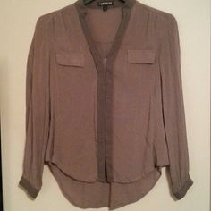 Express button up blouse Nude and taupe colored Express button up with hidden button detail on front, says xs but I wear a medium and it fit me good so could fit a medium or small also. Gently worn but in perfect condition Express Tops Button Down Shirts