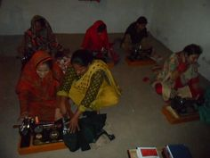 Mrs Christina instructing and giving training to the girls and women of AWE sewing center.