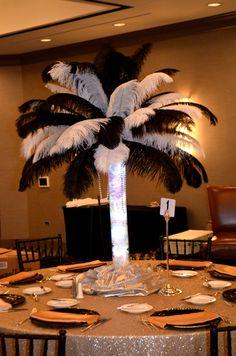 Feather Centerpiece | Great Gatsby http://www.idealpartydecorators.com