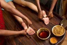 Indian practitioners give a traditional Ayurvedic oil foot massage.
