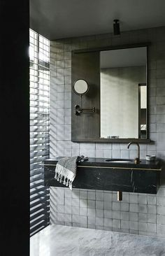 I like this setup: the tiles, the vanity unit, the wooden backed mirror, the marble floor too