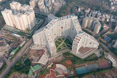 MVRDV has completed Future Towers, an enormous apartment building in Pune, India, featuring blocks with sloping roofs and courtyards Roof Architecture, Residential Architecture, Architecture Images, Contemporary Architecture, Orient House, Natural Structures, Social Housing, India, Affordable Housing
