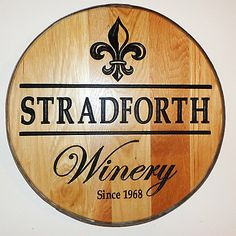 Personalized Reclaimed Wine Barrel Head with Winery and Fleur de Lis at Wine Enthusiast - $349.00