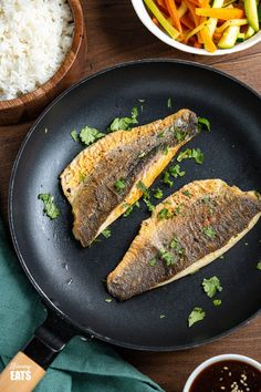 Pan-fried Sea Bass with Ginger Soy Sauce - delicious sea bass cooked in a pan and served with a simple honey soy sauce fragranced with fresh ginger. #fish #soy #honey #slimmingworld #weightwatchers