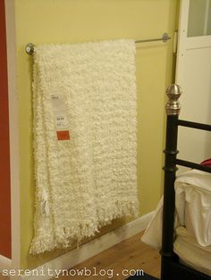 Blanket storage on bedroom wall - great for pretty winter quilts to hang up on in warmer months