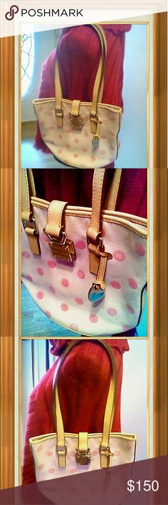 """Dooney and Bourke Canvas  Shoulder Bag Purse has interior zip pocket and a swivel hook with a push lock latch measuring 9"""" with a double strap drop. Purse measurements are 8""""L ?9""""H ? 5.5""""W Dooney & Bourke Bags Shoulder Bags"""