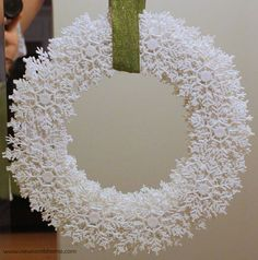 snowflake-wreath. Could also sponge paint on some pale blue or some silver glitter or both. I think I would want a red or navy ribbon too.