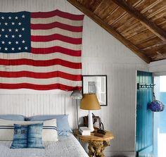 small seaside cottage bedroom + flag // captain jack's wharf