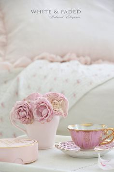 Vintage China from our shop. Pink linen ruffled pillow in the background White & Faded collection.