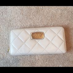 White Michael Kors wallet White Michael Kors wallet. Used but good condition. Michael Kors Bags Wallets