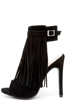 """No matter where you step, the In the Right Direction Black Suede Fringe Heels will make you worth watching! These eye-catching, vegan suede peep-toe heels have a layer of fringe that cascades from the collar, plus a belted accent with gold buckle. 6.5"""""""" zipper at the instep. #fashion #style #streetstyles #popsugar #wachabuy #apparel"""