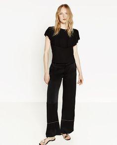 Black Frill Detail T-Shirt by Zara   $19.90