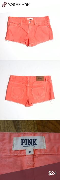 """VS PINK Bright Coral Denim Cutoff Shorts Great condition overall. I did see a couple of small faded spots (see 4th pic) when I was looking over these. They're hard to see. Company distressed so there are lightened and faded areas. 100% cotton.   Waist approx 15 1/4"""" across when flat, rise 8"""", inseam 2"""". PINK Victoria's Secret Shorts Jean Shorts"""