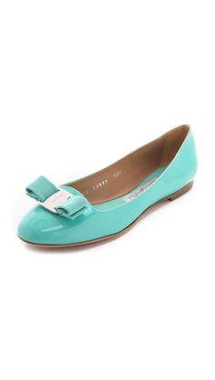 Salvatore Ferragamo Scott Smoking Flats bright patent leather makes its flats an inviting, calssic staple. a tonal grosgrain bow loops through the polished logo medallion at the vamp, and the footbed is padded for extra comfort. nonslip rubber patch at leather sole.  perfectly perfect.