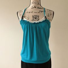 CLEARANCE SALE - Teal Sleeveless Summer Top This teal color summer top is cute and original. Size M but fits S as well without feeling too loose. White undershirt wears like a bra (no cupholders). Shows some signs of wear but still in good shape. Tops Tank Tops