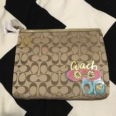 Coach Laptop Case BNWT. Authentic Coach laptop case or can be used for any portable device (iPad, kindle). Color is brown, with pink and blue design in bottom right corner. Inside is a pink/magenta color. Sides have thick padding for protection. Coach Accessories Laptop Cases
