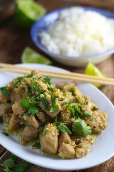 Chicken is marinated in a tangy blend of lemongrass, fish sauce, and chiles. Then quick-fried and served topped with cilantro and toasted rice powder.