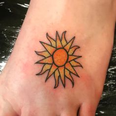 Colored Sun Tattoo On Foot Tattoo Placement Foot, Cute Foot Tattoos, Sun Tattoo Designs, Sun Designs, Sun Tattoos, Sleeve Tattoos, Tatoos, Simple Sun Tattoo, Color Tattoo