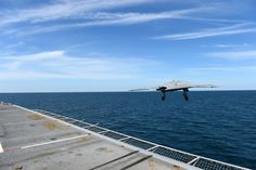 (May 14, 2013) An X-47B Unmanned Combat Air System (UCAS) demonstrator launches from the flight deck of the aircraft carrier USS George H.W. Bush (CVN 77). George H.W. Bush is the first aircraft carrier to successfully catapult launch an unmanned aircraft from its flight deck.