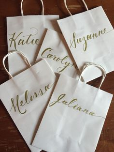 Personalized Gift Bag, Gold, White, Hand-lettered, Customized, Bridesmaid Gift, Groomsmen, Bridal Party, ANY COLOR by PenandLetter on Etsy https://www.etsy.com/listing/243356691/personalized-gift-bag-gold-white-hand