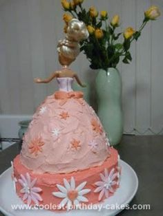 Homemade Pretty in Pink Barbie Cake: I made this Pretty in Pink Barbie cake for my little girl's 4th birthday. It was a huge success and given results was very easy. I made the candy decorations