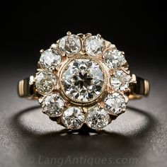 Victorian Rose Gold and Diamond Cluster Ring.  bright and beautiful European-cut diamond, weighing .83 carat, is bezel-set and orbited by ten smaller diamonds of like cut and totaling 1.00 carat in this late-Victorian (circa 1890-1905) super-sparkler crafted in 18K rose gold. The top of the ring measures 1/2 inch across