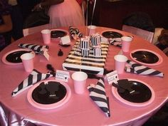 Pink table clothes and black/white striped napkins