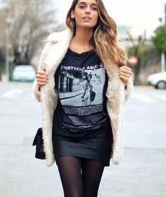 .leather skirt, pop culture t-shirt, dark tights, light coat Great for a night out when its chilly.
