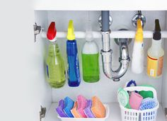 Rescue your under-sink cabinet from clutter by enlisting help from a tension rod