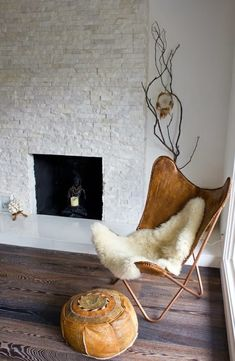 leather butterfly chair + faux sheepskin throw
